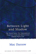 Cover of Between Light & Shadow: The World bank, the IMF and International Human Rights Law